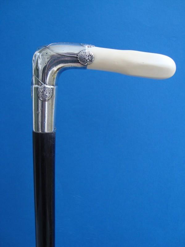 An ivory and silver handle