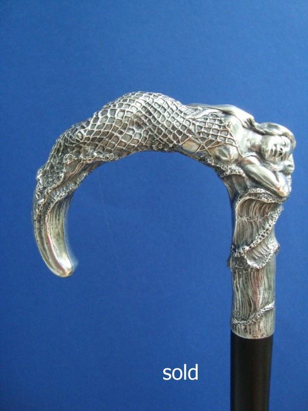 Meerjungfrau im Fischernetz