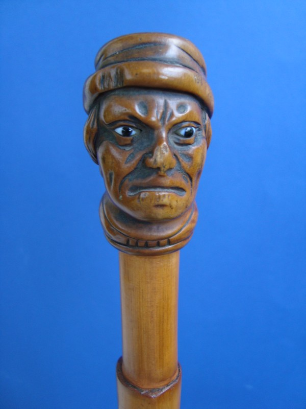 A wood bust of a men