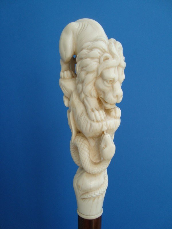 An ivory lion and snake