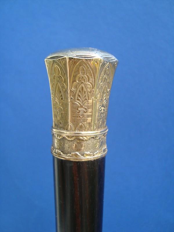 A silver gilded knob